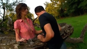 Horny legal time teenager chick copulates overhead a fallen treen outdoors with comrade-in-arms